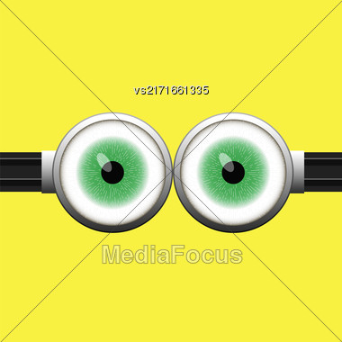 Goggle With Two Green Eyes On Yellow Color Background Stock Photo
