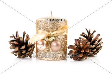 Gold Candle With The Baubles And Cones Stock Photo