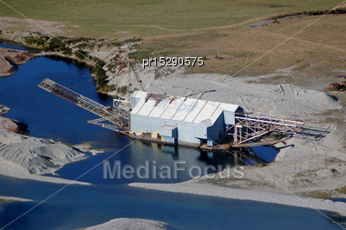 Gold Dredge On The Grey River, South Island, New Zealand - The Last Of Its Kind In The World Stock Photo
