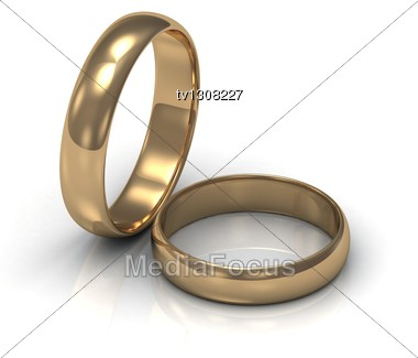 Gold Ring Near The Ring. 2 Wedding Rings Stock Photo