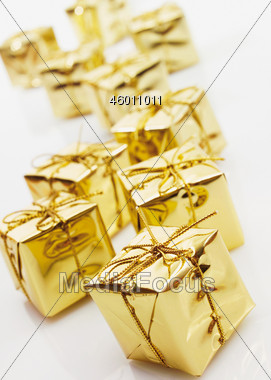 Gold Wrapped Christmas Presents Stock Photo