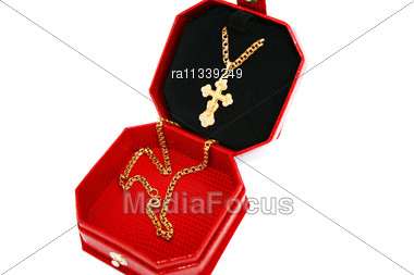 Golden Cross And Chain In Jewelery Box Stock Photo