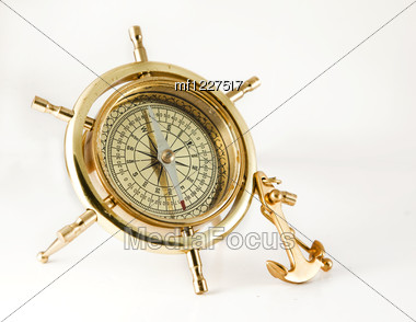 Golden Old Compass With Anchor Stock Photo