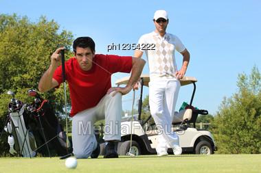 Golfer Kneeling Stock Photo
