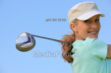 Golfer Taking A Swing Stock Photo