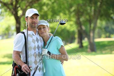 Golfing Couple Stock Photo