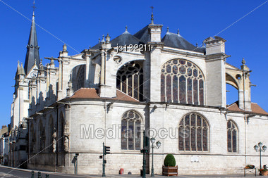 Gothic Catholic Church With Its Bell Tower On Blue Sky Background Stock Photo