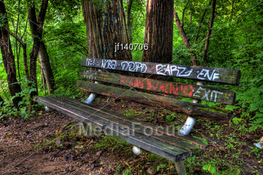 Graffiti Bench In The Woods In High Dynamic Range Stock Photo