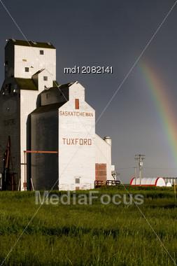 Grain Elevator And Rainbow In Saskatchewan Canada Stock Photo