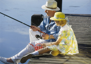 Grandfather Going Fishing with Granddaughter Stock Photo