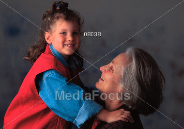 Grandma Lifting Up Granddaughter Stock Photo