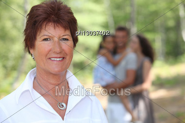 Grandmother Enjoying A Day Out With Her Family Stock Photo