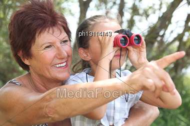 Grandmother With Granddaughter And Binoculars Stock Photo