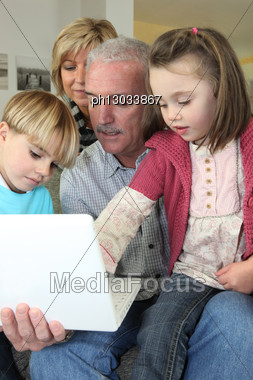 Grandparents Spending Time With Their Grandchildren Stock Photo