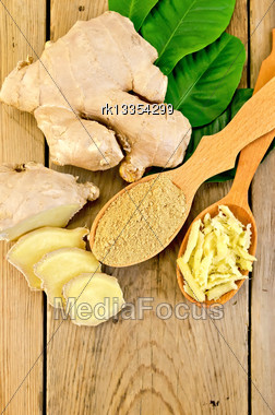 Grated And Ground Ginger In Two Wooden Spoons, Ginger Root, Green Leaves On The Background Of Wooden Board Stock Photo