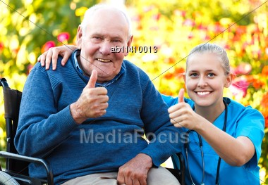Great Mood At The Nursing Home, Happy Patient With Doctor Stock Photo