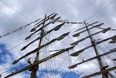 Greater Mast Of A Sailing Vessel On A Background Of Clouds Stock Photo