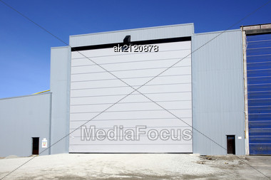 Greater Rising Gate Of Industrial Facility Stock Photo