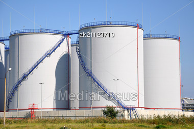 Greater White Fuel Tanks On A Background Of The Blue Sky Stock Photo