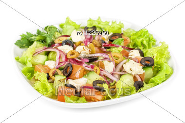Greece Salad At Plate Isolated On A White Stock Photo