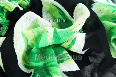 Green And Black Fabric As A Background. Stock Photo