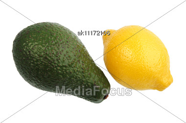 Green Avocado And Yellow Lemon. Close-up Stock Photo