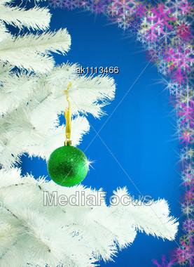 Green Ball Hanging On The Christmas Tree Stock Photo