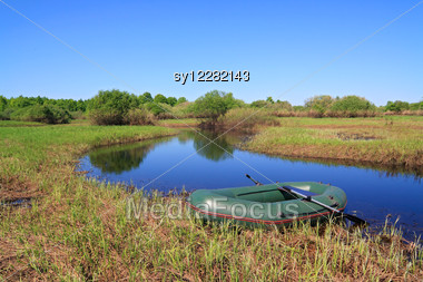 Green Boat On Small River Stock Photo