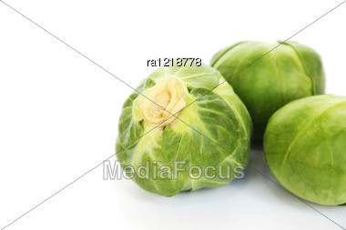 Green Brussels Sprouts On White Background. Stock Photo