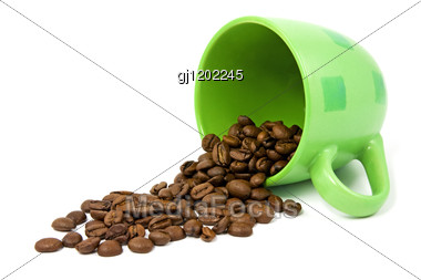 Green Cup With Coffee Beans Stock Photo