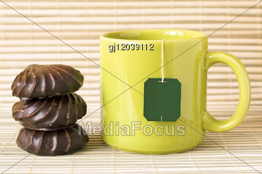 Green Cup Of Tea And Chocolate Marshmallows Stock Photo