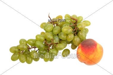 Green Grapes Bunch And One Orange Peach. Close-up Stock Photo
