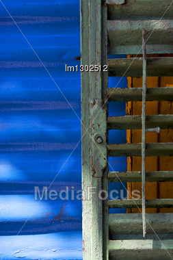 Green Iron Venetian Blind And A Blue Metal Wall In La Boca Buenos Aires Argentina Stock Photo