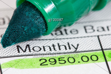 Green Marker And Payslip With Monthly Wage Stock Photo