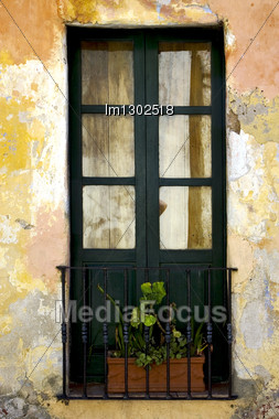 Green Old Window Little Terrce And Flower In The Centre Of Colonia Del Sacramento Uruguay Stock Photo