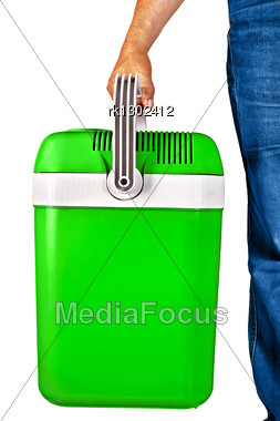 Green A Small Portable Cooler For Travel In The Hands Of A Man Stock Photo