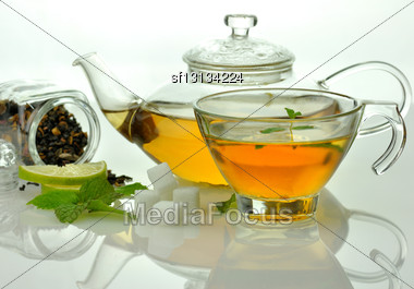 Green Tea Composition With Teapot,cup ,lime And Peppermint Stock Photo