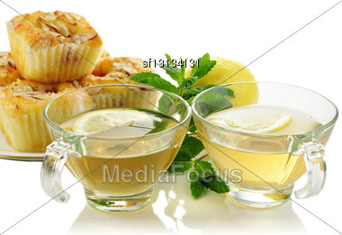Green Tea With Raspberry Cupcakes With Almonds , Close Up Stock Photo