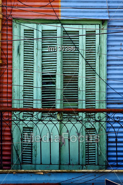 Green Wood Venetian Blind And A Red Blue Metal Wall In La Boca Buenos Aires Argentina Stock Photo