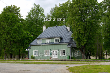 Green Wooden Two-storeyed House Stock Photo