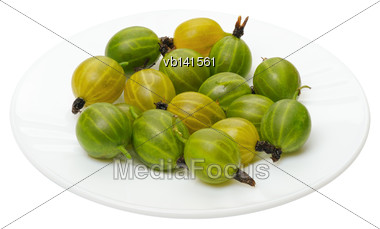 Green And Yellow Gooseberry On A White Plate, Isolated Stock Photo
