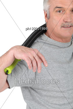 Grey-haired Man Stretching In The Gym Stock Photo