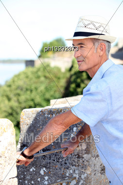 Grey-haired Man Visiting Port Town Stock Photo