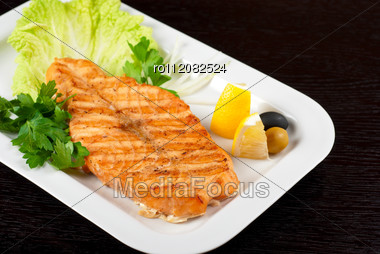 Grilled Salmon Steak With Greens,onion, Lemon, Lime And Olive Stock Photo