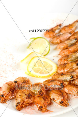 Grilled Shrimps With Lemon And Lime Closeup Stock Photo
