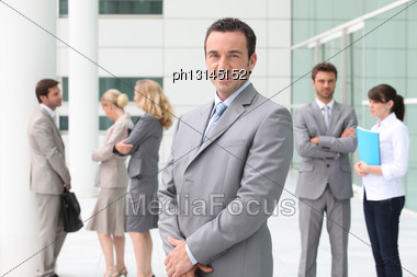 Group Of Business People Stood Outside Building Stock Photo