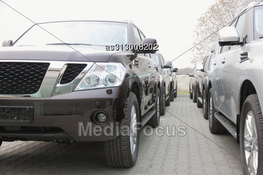 Group Of Cars Stand In One Number Of Dark Color Stock Photo