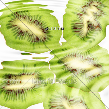 Group Of Cross A Kiwi-fruits Under Water. Abstract Background. Close-up. Studio Photography Stock Photo