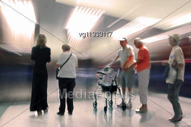 Group Of An Elderly Patients Standing In The Lobby,man With Walker And Assistant, Intentional Motion Blur And Tint Stock Photo