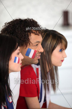 Group Of French Supporters Watching A Football Game Stock Photo